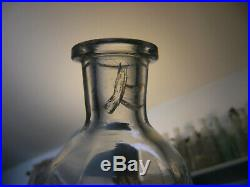Vintage Old Hudson whiskey decanter bottle. White glass lettering pinched bottle