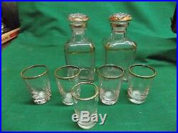 Vintage stack of books hidden liquor bar with glasses decanters. France